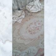 beige needlepoint rug