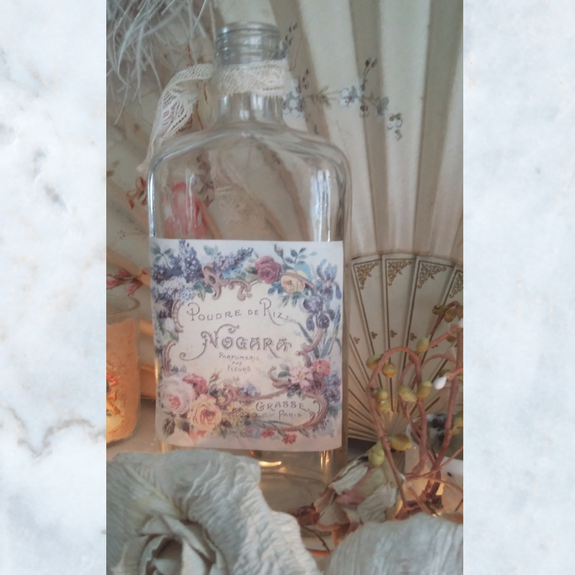 Vintage perfume bottle with lace