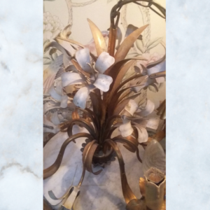 gilt chandelier with white flowers
