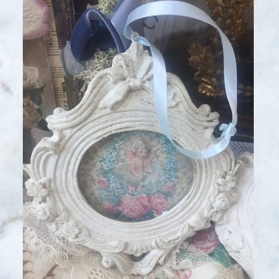 picture frame with cherub
