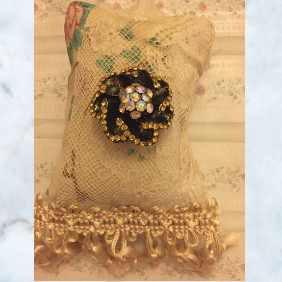 antique pillow with brooch